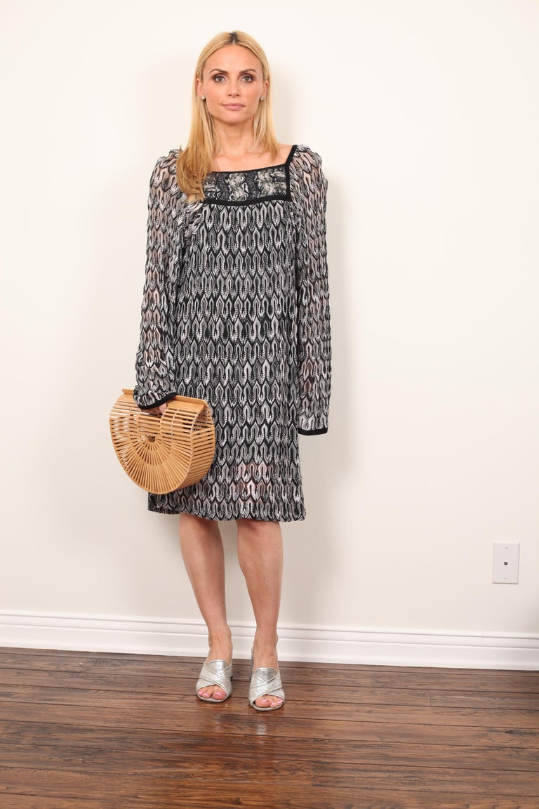 This Missoni can be worn from Day to Night on your next vacation. Wear as a bathing suit cover-up with a hat and some sandals or pair with a heel and an earring and wear to dinner.   Swing silhouette with bell sleeves.  Color - Black & White with