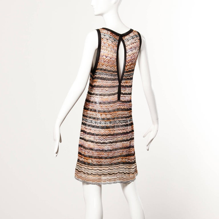 Zig Zag knit Missoni dress with a cut out open back.  Details:  Unlined Back Snap Closure Estimated Size: Small-Medium Color: Black/ Beige/ Purple/ Orange Fabric: 100% Rayon Knit Label: Missoni  Measurements:   Bust: 36