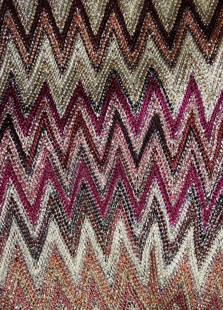Stunning Missoni multicolored Lurex-knit zigzag kaftan dress V-neck Ruching on shoulders Slit kimono-style sleeves Pink self-tie crepe belt with feeds through slits at the sides Vents at the hem Simply slips on Made in Italy Dry Clean Only Size 40