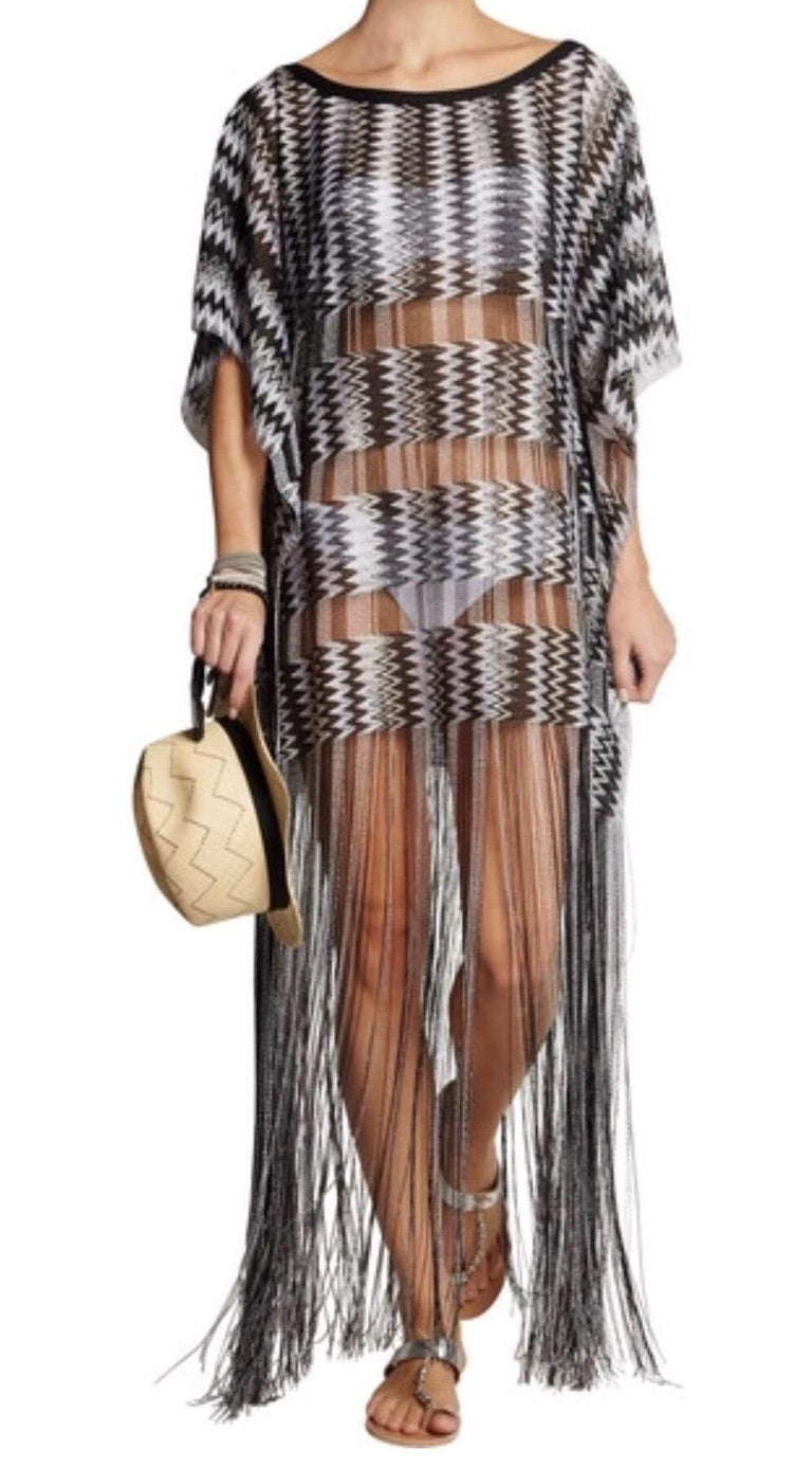 Missoni's semi-sheer kaftan has been crafted in Italy using the label's signature crochet-knit technique. The relaxed shape makes it perfect for slipping on over a bikini, and we love how the fringing swishes as you walk.   Missoni signature black
