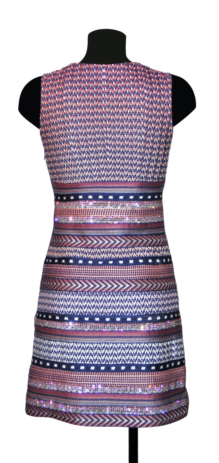 Very chic round-neck and sleeveless dress from the house of Missoni. Crafted in a multicolor fabric with stripes design of colors and strass.  Fabric: 70% rayon, 28% cotton, 2% wool Lining: 97% polyester, 3% elasthane Color: multicolor Size: