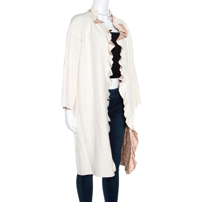 A sleek and stylish coat is a must have in every winter wardrobe for the fashionable woman in you, and this Missoni coat is sure to steal hearts with its minimal style and effortless elegance. Constructed in an off-white hue with a silk and linen