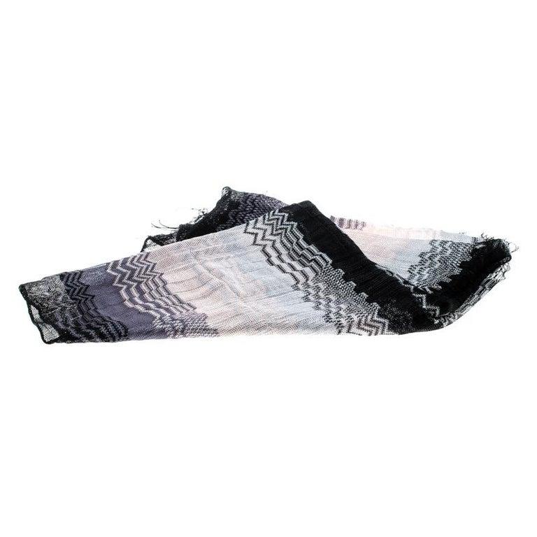 Accessorise with ease using this lovely ombre scarf from Missoni. It has been loosely knit in a chevron design and finished with tassels.  Includes: The Luxury Closet Packaging  The Luxury Closet is an elite luxury reseller specializing in the