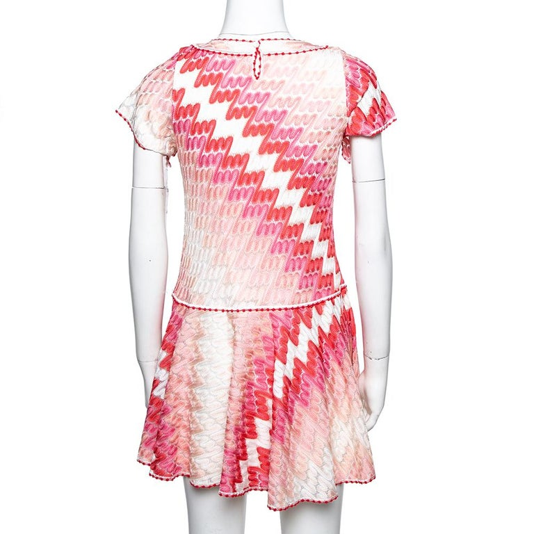 From the house of Missoni, this dress is a classy piece to own. This skater dress is the right fusion of sophistication and comfort as it smoothly takes you through the day. It is complete with a beautiful pattern in a pink hue all over.