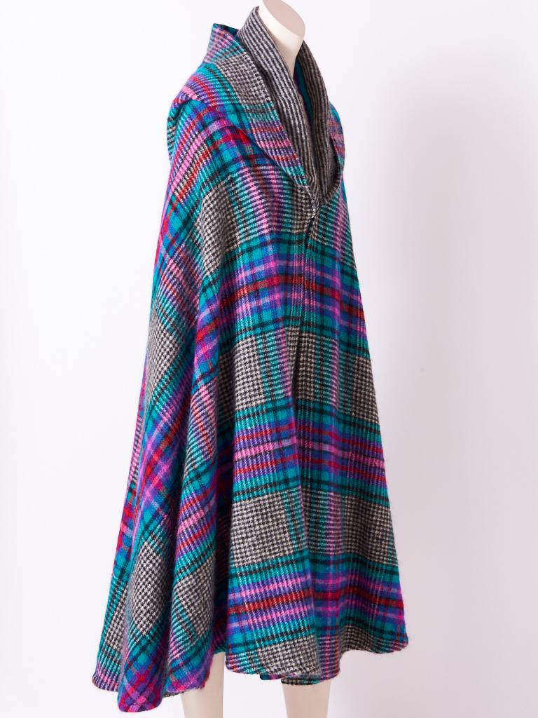 Missoni, wool knit, multi tone, midi length, cape with hood having a plaid motif on a black and white heather ground.