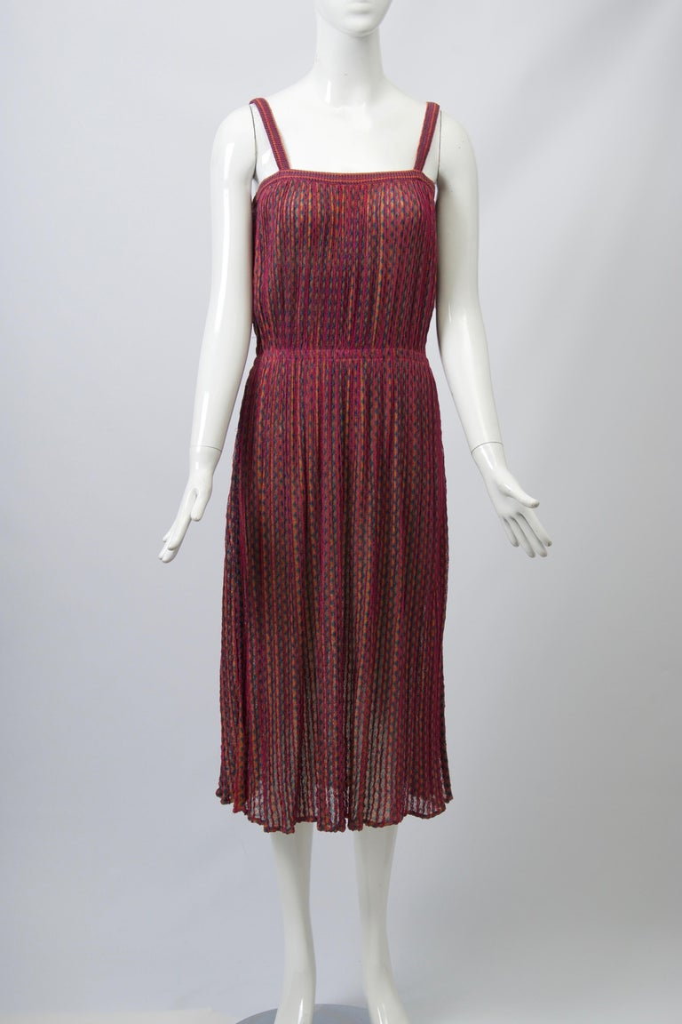 Missoni sundress, c.1970s-'80s, with spaghetti straps and interior elastic band that gathers the fabric in at the waist. Predominantly raspberry zigzag stripe knit. Light, packable and easy to wear. Unlabeled, except for size S (waist flexible).