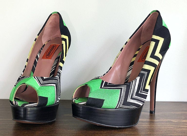 Add a bit of jazz to any outfit in these MISSONI peep toe platform high heels ! Features the signature chevron zig zag patterns in kelly green, yellow, white and black. Stacked platform makes these comfortable for all day wear. Only worn once on a