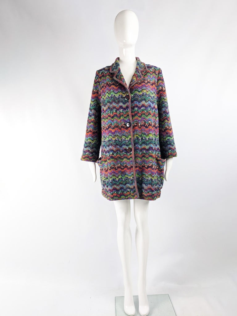 A beautiful vintage womens Missoni for Neiman Marcus swing coat from the 80s. In a multicolored boucle wool knit with Missoni's iconig zigzag pattern knitted throughout and printed on the buttons.   Size: Unlabelled; fits a Small to Large due to