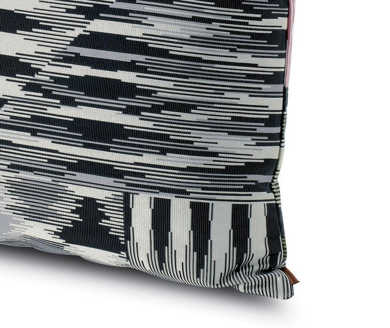 Decorative cushion in jacquard fabric in the iconic black & white patchwork-effect motif.   Composition: 42% Cotton, 30% Polyester, 28% Polyamide. Care: delicate dry-clean with perchlorethylene. Perfect for adding an elegant touch to any bedroom
