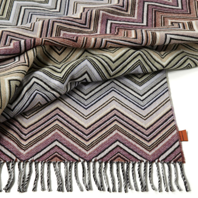 Wool and Cashmere throw in multicolor chevron. Presented in a branded gift box. Perfect for adding an elegant touch to any bedroom or living room.  Composition: 90% Wool, 10% Cashmere. Care: delicate dry-clean with perchlorethylene.