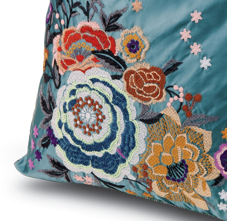 Detailed floral embroidery on one side and a field of shimmering Missoni chevrons on the reverse. Perfect for adding an elegant touch to any bedroom or living room.  Composition: 45% Acrylic, 45%Wool, 10%Polyester. Care: delicate dry-clean with