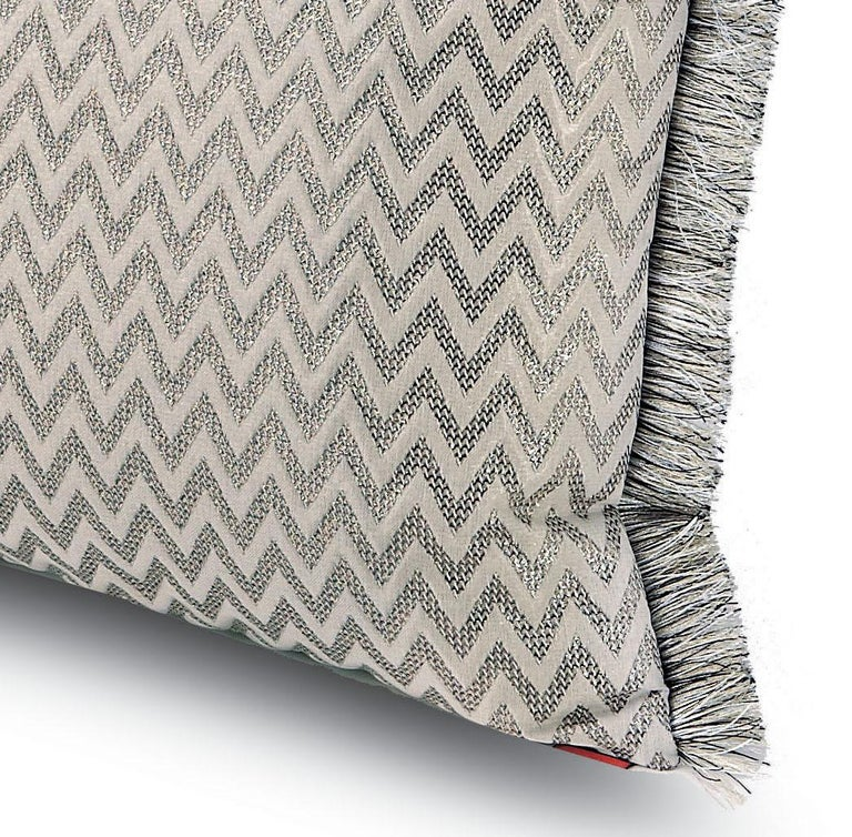 Embossed chevron jaquard cushion in ivory and silver chevron print with fringe trim. Perfect for adding an elegant touch to any bedroom or living room.   Composition: 60% Polyester, 40% PA. Care: delicate dry-clean with perchlorethylene.