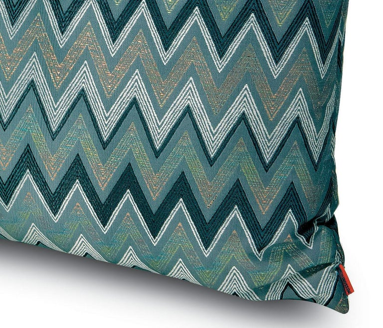 Cushion in shaded metallic chevron jacquard fabric. Dimensions: 16x16 inches. Packaged in disposable plastic. Perfect for adding an elegant touch to any bedroom or living room.  Composition: 48% Polyester, 33% Cotton, 14% Acetate, 5% Metal Fiber.