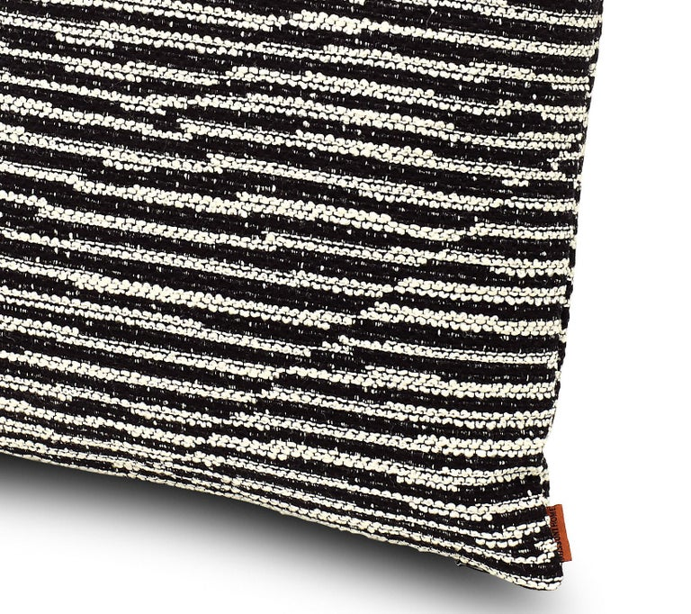Cushion in yarn-dyed jacquard fabric with black and white stripe patchwork. Dimensions: 16x16 inches. Packaged in a disposable plastic cover. Perfect for adding an elegant touch to any bedroom or living room.  Composition: 55% Cotton, 35% Wool,