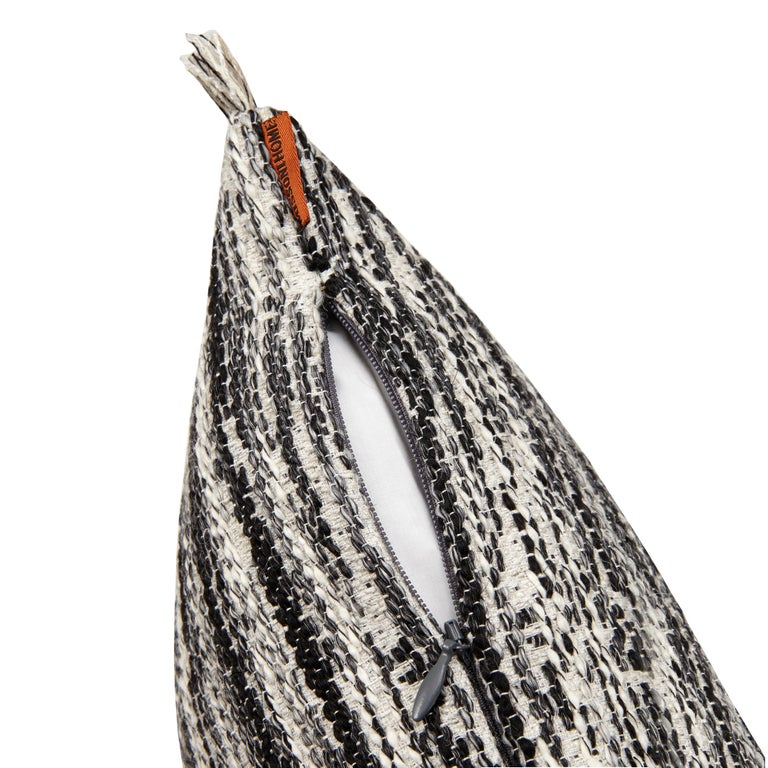 MissoniHome's yarn-dyed flame stitch pattern in black and white and fringes on the edge with removable cover; 95/5 insert fill.