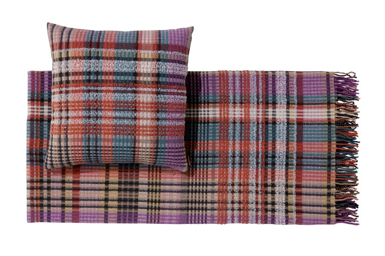 MissoniHome's wool, plaid striped throw with a raised boucle-style striped design on the ends along with fringes; size 51 x 75 inches. Presented in a branded MissoniHome box.