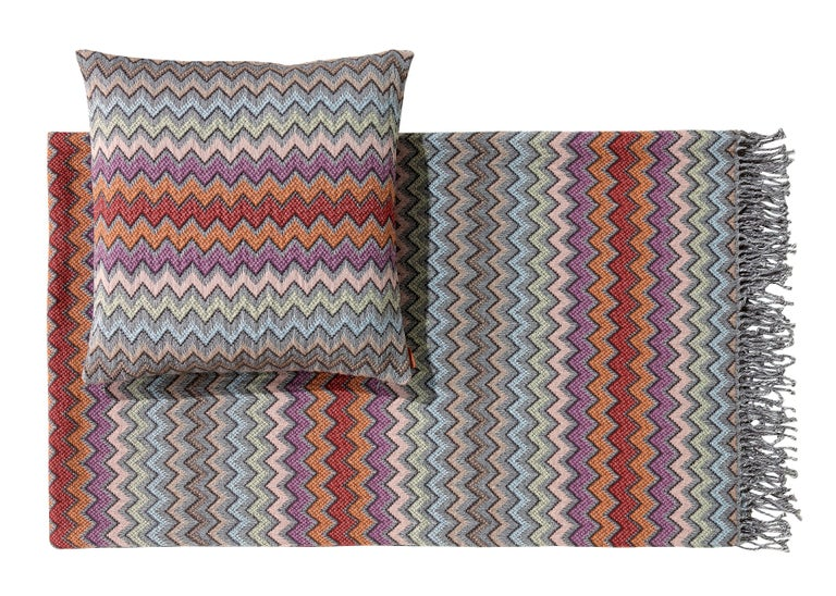 MissoniHome's iconic chevron pattern cushion in tones of softer pinks, blushes, reds and grays; size 16 x 16 inches. Matching throw to pair back to cushion available. Presented in a branded MissoniHome box.