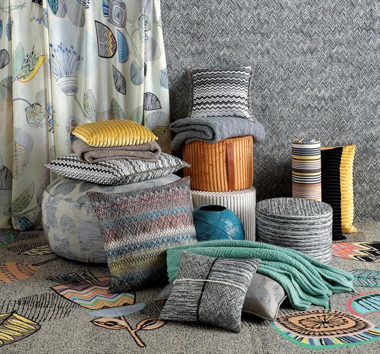 MissoniHome's cushion with a multicolored stripe; 95/5 insert fill.