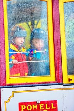 Children looking from Rainy San Francisco Street Car