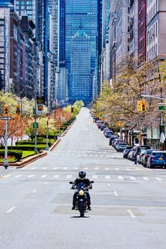 Covid-19 New York City, Empty Park Avenue no Traffic Except a Lone Motorcycle