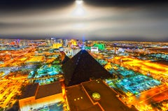 Elevated View Of Las Vegas At Night With Moonlit Sky