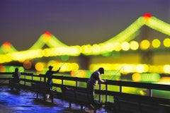 We Are All Fisherman.   Figures and Out of Focus Lights San Francisco Bay Bridge
