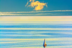 Lone Sailboat on a placid turquoise sea
