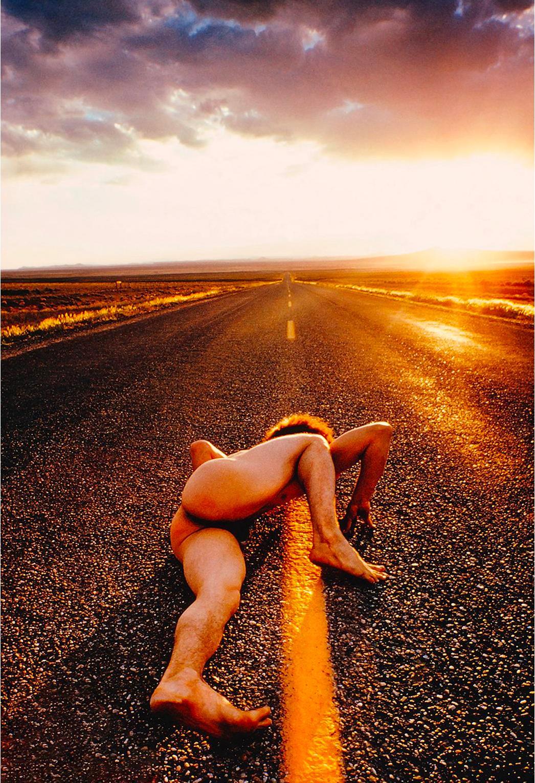 Nude man on Endless Surreal  Arizona Road