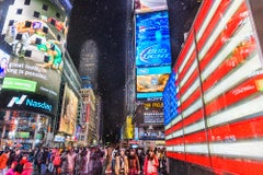 Times Square during snowstorm and American Flag