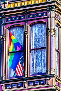 Victorian House Window With Pride Flag And American Flag, San Francisco
