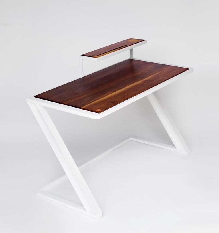 A modern and clean twist on the traditional writing desk. The