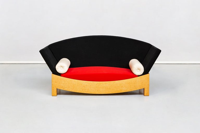 Mitzi Sofa, Hans Hollein for Poltronova, 1981 Wooden structured sofa, padded with polyurethane foam, fabric covered. Basement veneered in blonde briar-root. The uniqueness of the object is the great mix of colors and geometric lines.