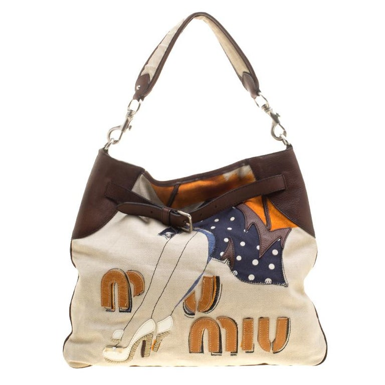 c5983b88c Miu Miu Beige/Brown Canvas Embroidered Shoulder Bag For Sale. The house of Miu  Miu takes all your woes away with this chic ...