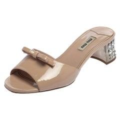 Miu Miu Beige Patent Leather Bow Embellished Mules Sandals Size 36