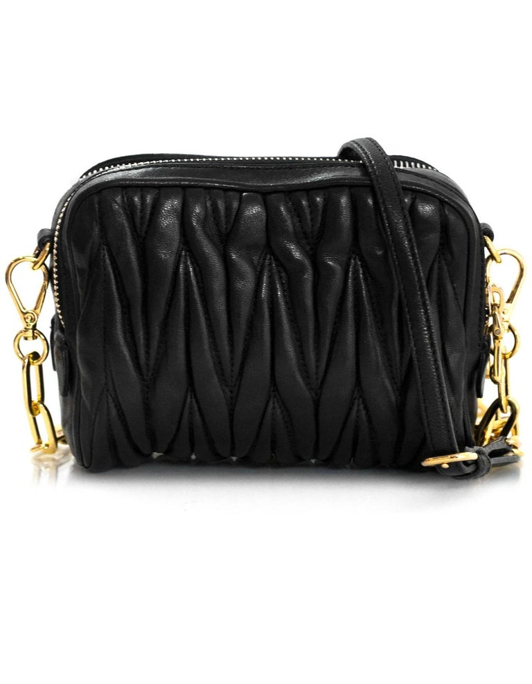 ... Color  Black Hardware  Goldtone Materials. Miu Miu Black Nappa Leather  Matelasse Lux Camera Crossbody Bag In Good Condition For Sale In 8cab4956d138a