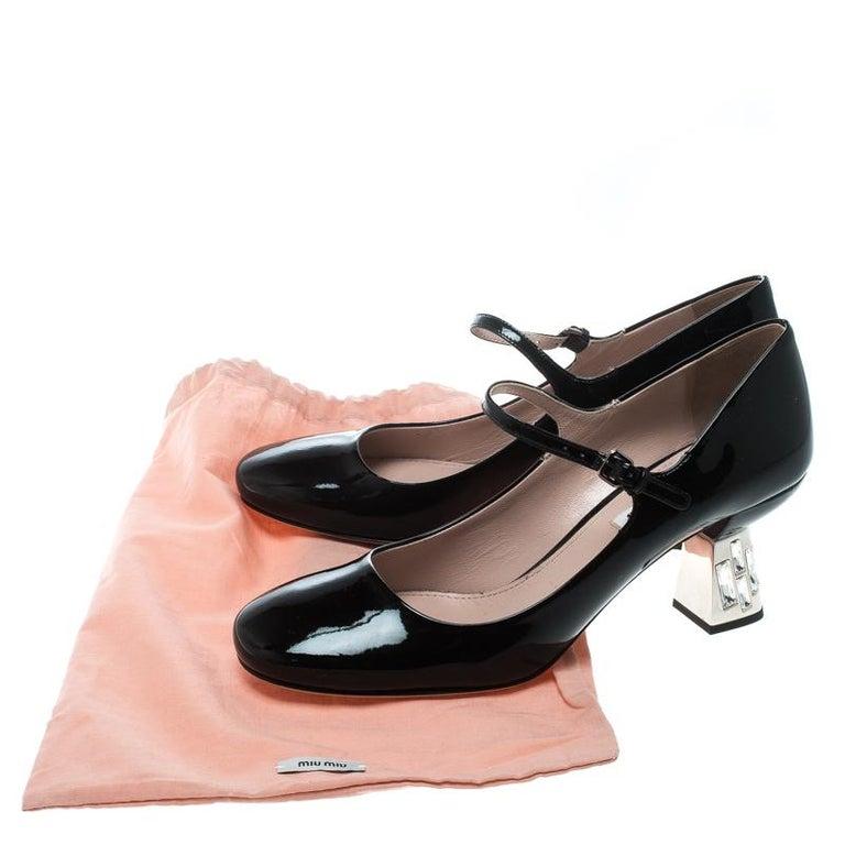 Miu Miu Crystal-embellished patent-leather pumps Black