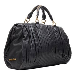 MIU MIU black pleated leather gold studded handle top zip shoulder strap bag