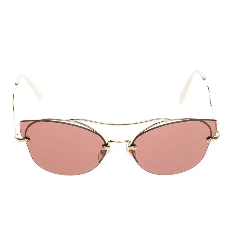 4ecb3346ae80 Designed in a glamorous cat eye shape, these Miu Miu aviator sunglasses  feature an extended