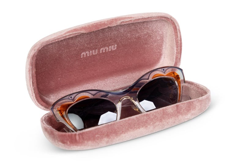 From the Spring 2014 , featured on the runway and that season's eyewear campaign modeled by Elle Fanning. Transparent plastic sunglasses with blue and orange design. Gold tone logo at the temple and gradient lenses. Comes with case and dust cloth.