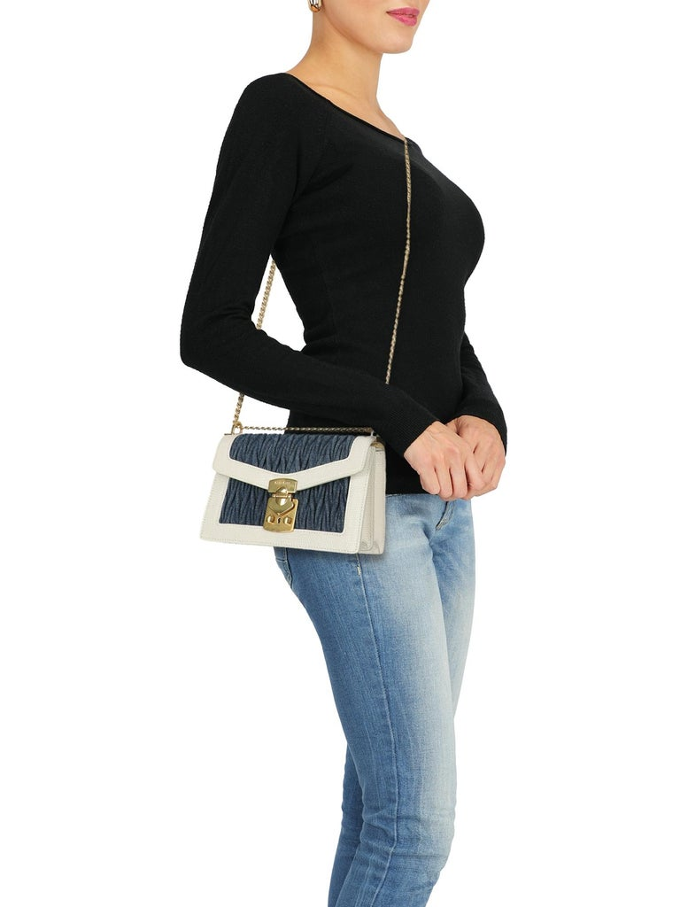 Cross body bag, leather, fabric, snake print, front logo, jeans, snap closure, gold-tone hardware, internal zipped pocket, internal pocket, multiple internal compartments, day bag  Includes: - Dust bag  - Product care   Product Condition: