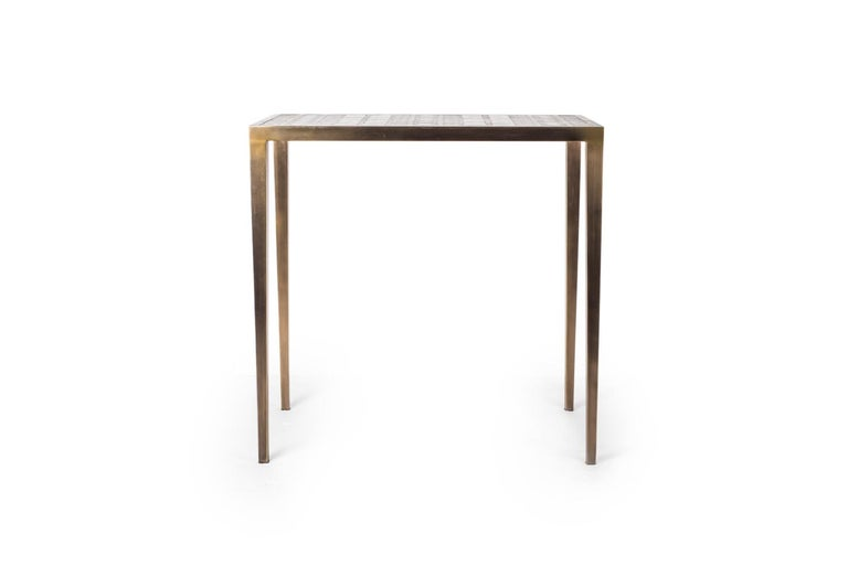 The mix media nesting side table in large is part of a series of nesting side tables (sold separately) . One can purchase the tables on their own or buy them as a set to create elegant & geometric shapes. This piece demonstrates the incredible