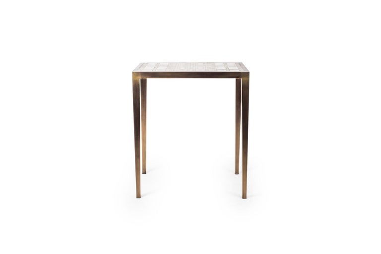 The mix media nesting side table in small is part of a series of nesting side tables (sold separately). One can purchase the tables on their own or buy them as a set to create elegant and geometric shapes. This piece demonstrates the incredible