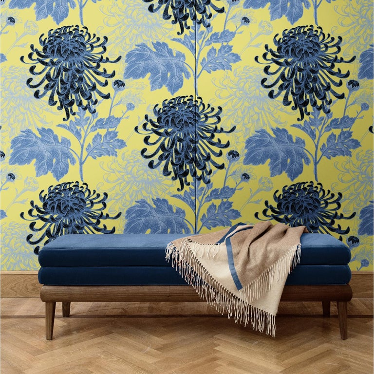 A mesmerizing juxtaposition of elegant dahlias depicted in blue tones over a mustard-yellow background, this elegant wall covering will make a statement in any home. It was crafted of silk and cotton and comes in two different versions: as boiserie
