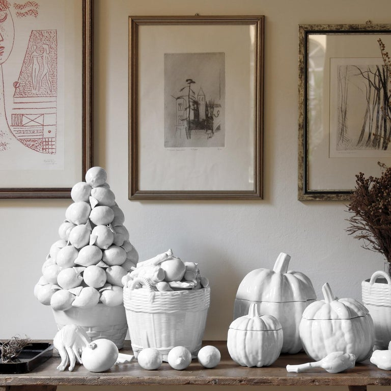 This exquisite ceramic topiary overflows with real-life fruit crafted by hand of glazed white ceramic to create a lovely centerpiece on a dining table in any modern or classic home. The composition of pears, lemons, grapes, leaves, apples, bananas,