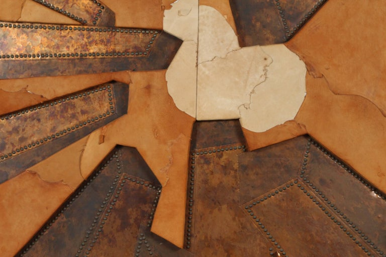 Mixed-media hammered copper and sued artwork title