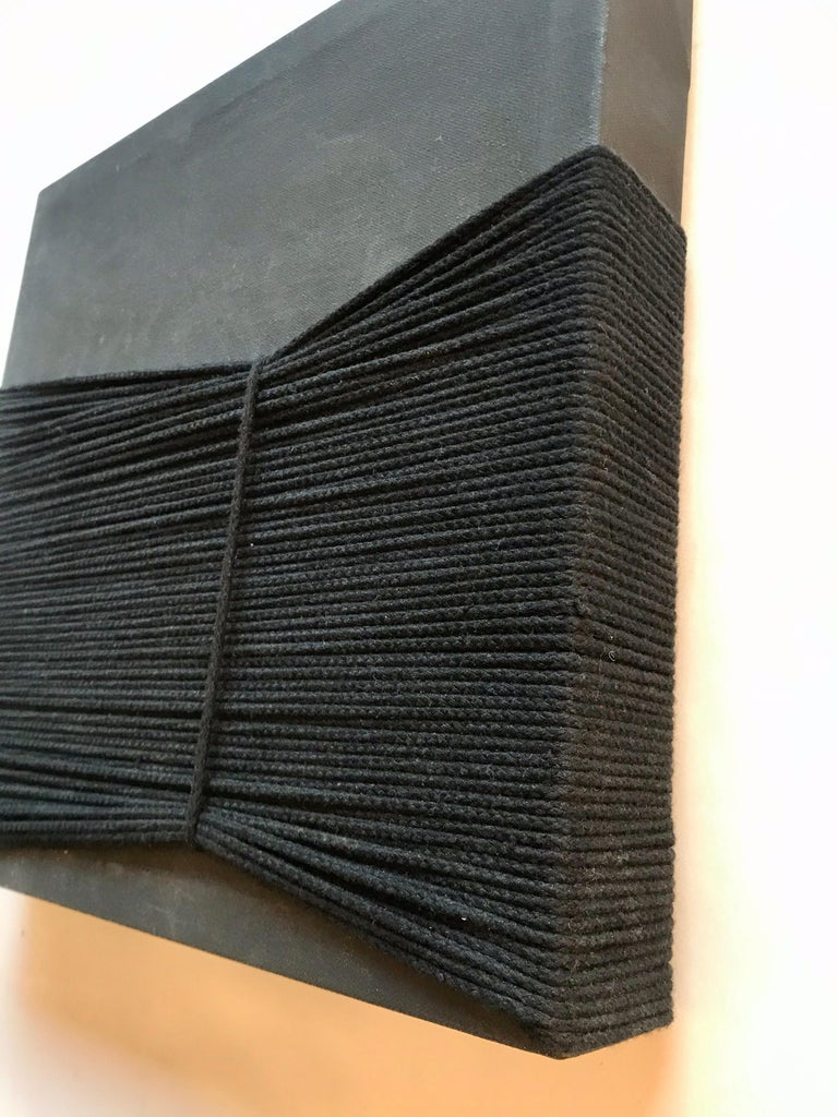 A nice piece of esoteric art black gesso with cotton sash cord on canvas.