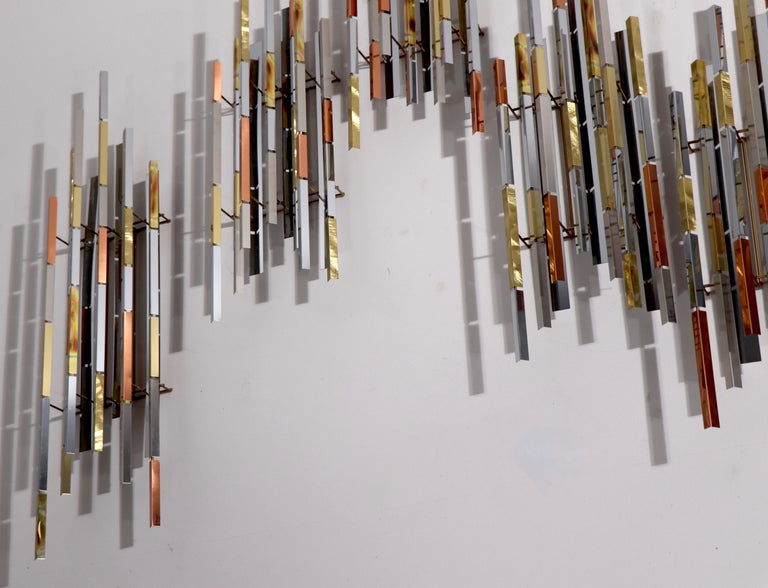 Spectacular wall mount Cityscape style sculpture signed R. Berger, dated 1993. This piece consists of 8 separate segments, of varying sizes (approx. 36 H x 8 W x 4 D each) which can be arranged to suit your space, and taste. The sculpture is in very