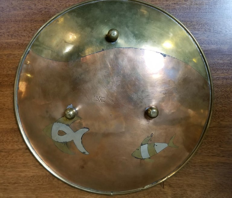 Handcrafted mixed metal footed plate in the manner of Los Castillo, Mexico, circa 1960s. Fish and kelp motif creating an underwater or fish tank design. In very good vintage condition with expected patina to finish.