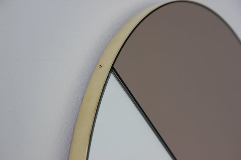 Mixed bronze and silver mirror tints Dualis Orbis with brass frame.