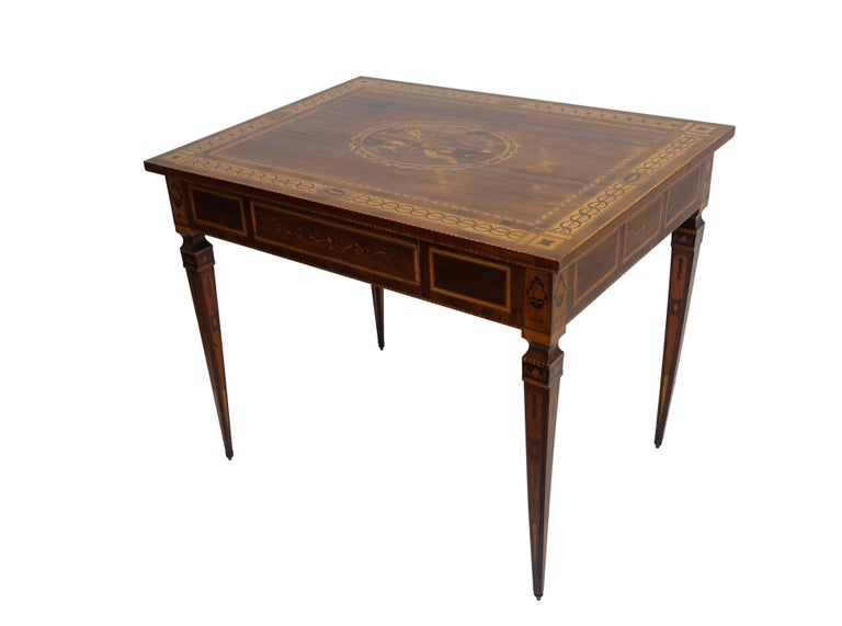 Fine Magilini style walnut and intricately inlaid fruitwood, walnut, black walnut, satinwood and rosewood center or writing table with one drawer on elegant tapering legs. Beautiful marquetry and parquetry work on all surfaces areas including the